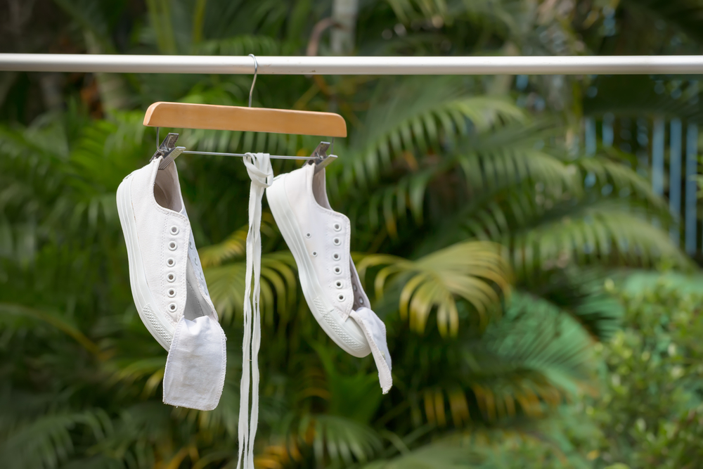 White sneakers hanging