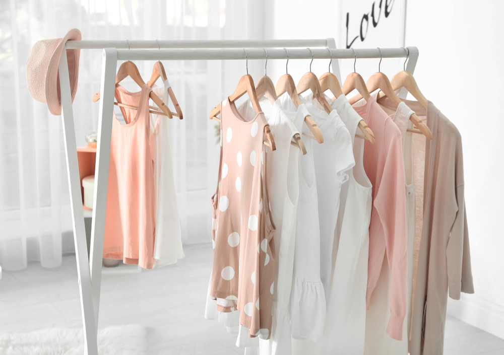 Women summer clothes hanging on rack