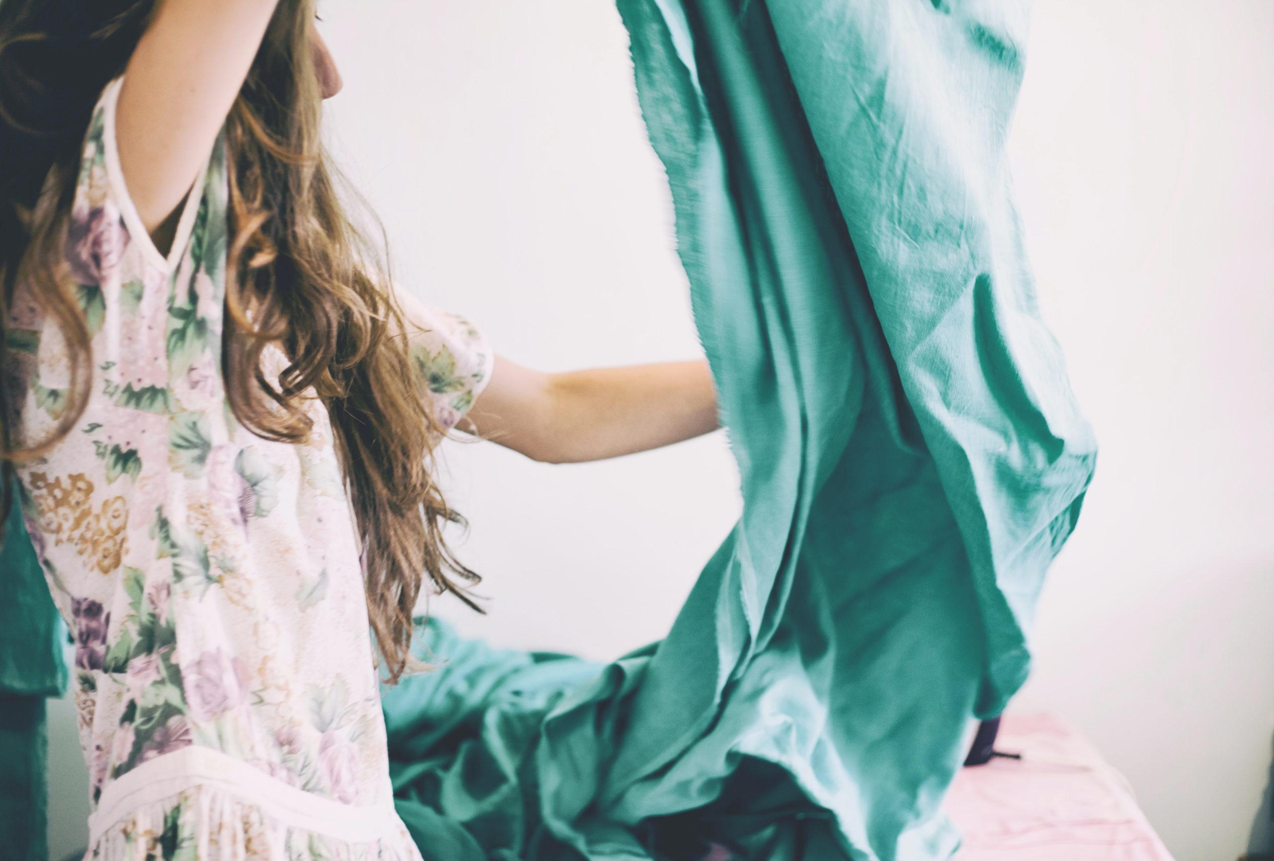 Woman detangling green bedding